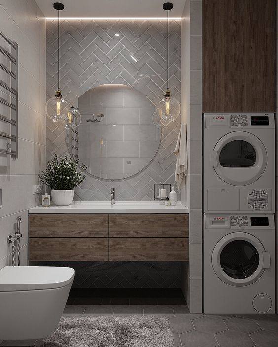 Organizzare lavanderia in bagno con asciugatrice e lavatrice