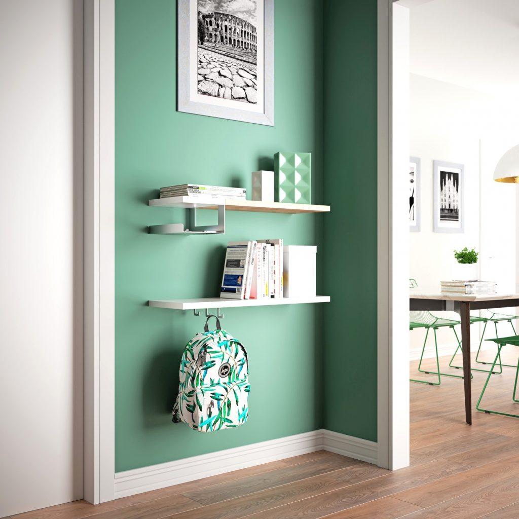 quadro appeso in cucina con parete verde