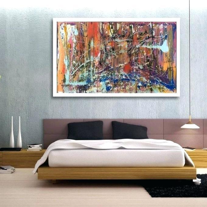 quadro grande sopra testata camera da letto