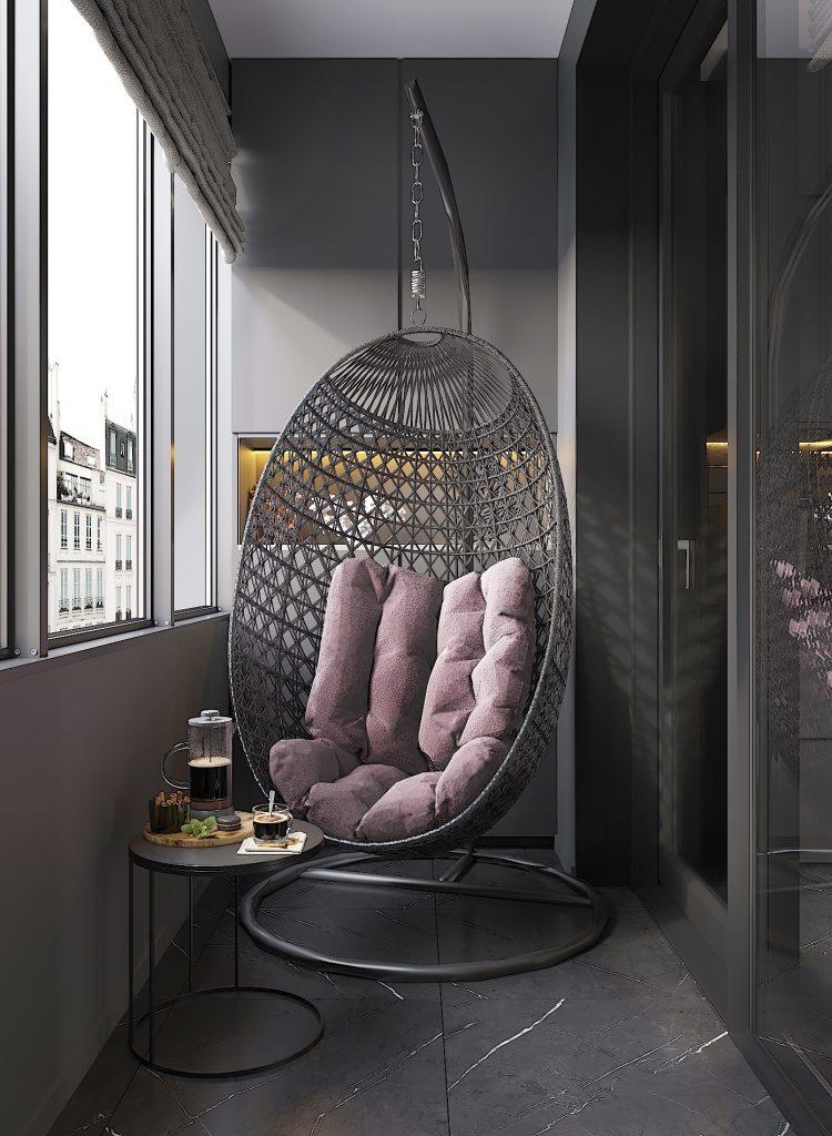 balcone con pavimento i marmo arredato con poltrona altalena grigia