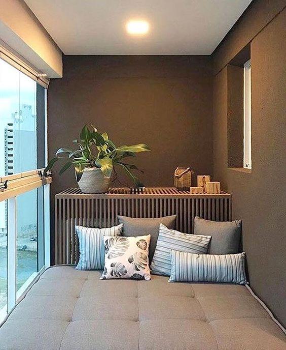 balcone arredato con divano letto