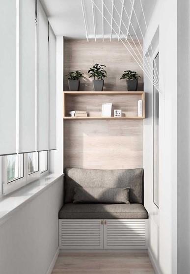 balcone stretto e lungo nicchia arredata con divano